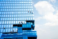 Free Bangkok, Thailand - September 27 2019: Team Worker Staff Is Cleaning The Glass On The High Building, Copy Space Background For Royalty Free Stock Photography - 160618097