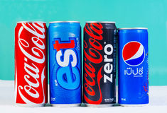 BANGKOK, THAILAND - SEPTEMBER 7, 2014: Cans of Coca-Cola, Pepsi. And est on ice. The four cans represent the popular soda drinks which sell around the world Royalty Free Stock Photos