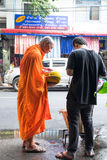 BANGKOK, THAILAND - 2016 SEPTEMBER 28 : A man offering food to a monk Stock Images