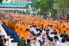 BANGKOK THAILAND - SEPTEMBER 08,2013: Many people give food and. Drink for alms to 10,000 Buddhist monks on September 08,2013 in Central World Street, Bangkok Stock Photography