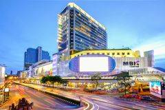 MBK shopping mall in Bangkok, Thailand at dusk with traffic Stock Images