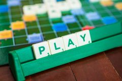 Play word made from Scrabble`s letter tiles. Bangkok, Thailand - September 19, 2018 : Play word made from Scrabble`s letter tiles stock photo