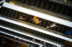 Bangkok, Thailand - September 12, 2013: Shoppers on escalator at Terminal21 shopping mall Stock Photo