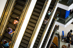 Bangkok, Thailand - September 12, 2013: Shoppers on escalator at Terminal21 shopping mall Royalty Free Stock Photo