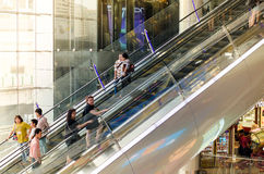 Bangkok, Thailand - September 12, 2013: Shoppers on escalator at Terminal21 shopping mall Royalty Free Stock Photography
