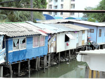 Bangkok-Thailand: Side canal Slum in Bangkok. Stock Images