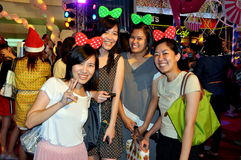 Bangkok, Thailand: Smiling Women on Christmas Eve Stock Images