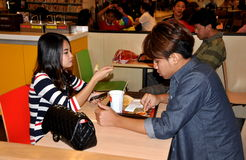 Bangkok, Thailand: Teens Eating at McDonald's Royalty Free Stock Image
