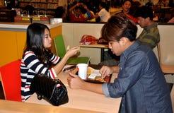 Bangkok, Thailand: Teens Eating at McDonald's Royalty Free Stock Image