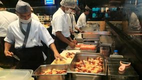 BANGKOK, THAILAND - 26th DECEMBER, 2017: Japanese restaurant in Siam Paragon. BANGKOK, THAILAND - 26th DECEMBER, 2017: The chefs in japanese restaurant in Siam stock video footage