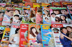 Bangkok, Thailand: Thai Magazines. A selection of Thai magazines, some in English, sold at a news stand on Thanon Phra Prachan in Bangkok, Thailand Stock Photos