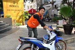 Bangkok, Thailand: Thai Man with New Moped Royalty Free Stock Image