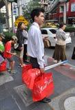 Bangkok, Thailand: Thai Man With Shopping Bags Royalty Free Stock Images