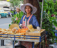 Bangkok, Thailand: Thai Street Food‎. Woman Selling Fruits at Bangkok, Thailand royalty free stock image