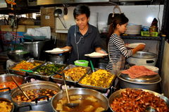 Bangkok, Thailand: Thais Selling Food at Market Hall Royalty Free Stock Photo