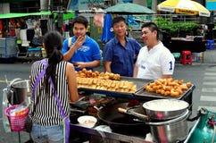 Bangkok,Thailand: Three Men Buying Food Royalty Free Stock Image