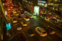 BANGKOK, THAILAND -  Traffic jam in city centre at night. Stock Photos