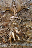 Bangkok, Thailand: Traimit Temple Doorway Carvings Stock Photography