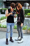 Bangkok, Thailand: Trendy Teens with Camera Stock Images