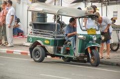 Bangkok, Thailand: Tuk-tuk on Wat Phra Kaew Royalty Free Stock Images