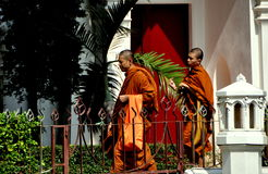 Bangkok, Thailand: Two Monks at Temple Royalty Free Stock Photos