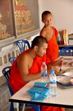 Bangkok, Thailand: Two Monks at Thai Temple Stock Photos