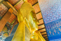 Bangkok, Thailand. Vintage retro effect filtered hipster style image of reclining Buddha gold statue Royalty Free Stock Image