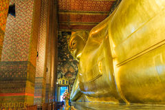 Bangkok, Thailand. Vintage retro effect filtered hipster style image of reclining Buddha gold statue Royalty Free Stock Photos