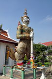 Bangkok, Thailand: Wat Arun Guardian Demon. One of the two giant guardian demons flanking the entrance to the Monastic quarters at Wat Arun (The Temple of Dawn) stock photo