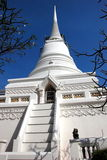 Bangkok, Thailand: Wat Pathum Wanaram Chedi. An imposing pure white bell-shaped Chedi with fine bas relief designs stands at the center of historic Wat Pathum Stock Images