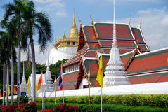 Bangkok, Thailand:  Wat Saket & Golden Mount. Wat Saket's magnificent Ubosot (sanctuary hall) with its multi-gabled roofs, white Chedis, and the view to the Royalty Free Stock Images