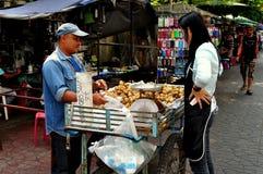 Bangkok, Thailand:Woman Buying Longan Fruit Stock Images
