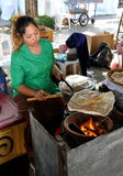 Bangkok, Thailand: Woman Cooking Flat Bread Royalty Free Stock Images