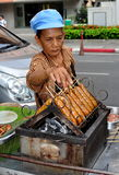 Bangkok, Thailand: Woman Grilling Sausages Royalty Free Stock Photo