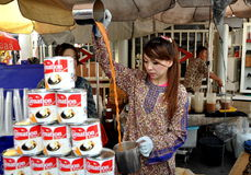 Bangkok, Thailand: Woman Making Double Tea Royalty Free Stock Photos