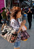 Bangkok, Thailand: Woman Praying at Shrine Stock Images