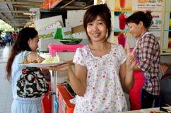 Bangkok, Thailand: Woman with Sausage Samples Royalty Free Stock Photos