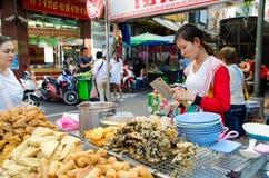 Bangkok, Thailand: Woman selling food Royalty Free Stock Photos