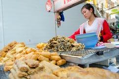 Bangkok, Thailand: Woman selling food Royalty Free Stock Photography