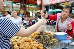 Bangkok, Thailand: Woman selling food Stock Image
