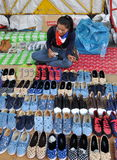 Bangkok, Thailand: Woman Selling Footwear Stock Photography