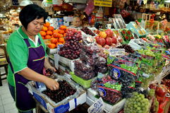 Bangkok, Thailand: Woman Selling Fruit Royalty Free Stock Images