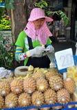 Bangkok, Thailand: Woman Selling Pineapples Stock Photo
