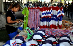 Bangkok, Thailand: Woman Selling Thai Political Souvenirs Stock Images