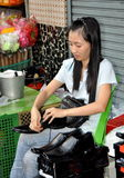 Bangkok, Thailand: Woman Shoe Seller Stock Image
