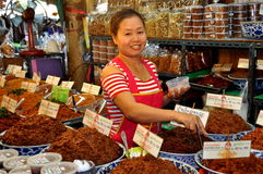 Bangkok, Thailand: Woman Vendor at Or Tor Kor Market Stock Photo
