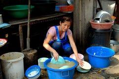Bangkok, Thailand: Woman Washing Dishes stock photos