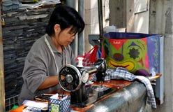 Bangkok, Thailand: Woman Working at Outdoor Sewing Machine Royalty Free Stock Image
