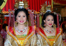 Bangkok, Thailand: Women in Chinese Clothing. Two beautiful women dressed in opulent Chinese clothing are part of the Central World shopping mall's extravagant Stock Image