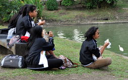 Bangkok, Thailand: Women Eating Lunch in Lumphini Park Royalty Free Stock Photography